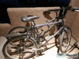 Pair of mens and womens Mountain Bikes